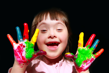 painted hands: Cute little girl with painted hands. Stock Photo