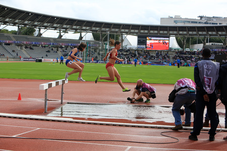 Athletes COMPETE on the 3000 meters steeple on DecaNation International Outdoor Games on September 13, 2015 in Paris, France Editorial