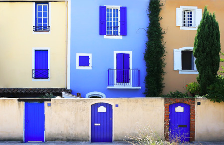 windows and doors: Mediterranean colors. Colorful wall with windows and doors