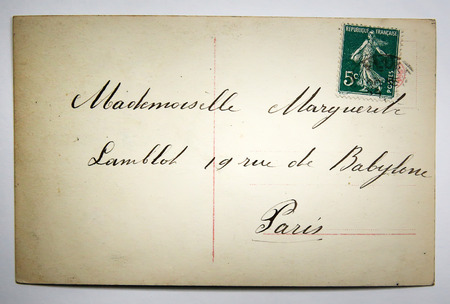 old envelope: Antique french postcard with stamp from paris. nostalgic retro style paper background