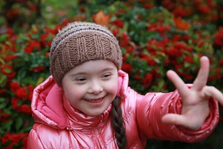 special education: Portrait of beautiful young happy girl Stock Photo