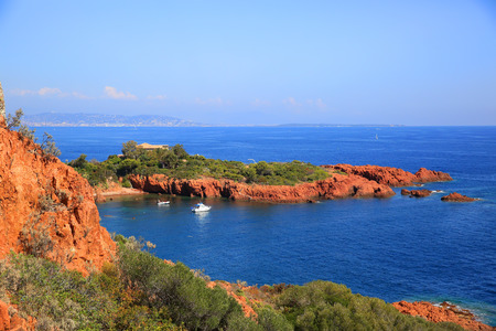 Esterel mediterranean red rocks coast, beach and sea. French Riviera in Cote d Azur near Cannes Saint Raphael, Provence, France, Europe