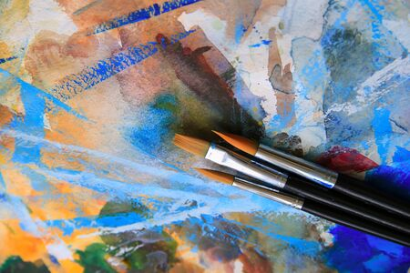 impression: Closeup of brushes and palette.
