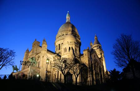 Basilica of Sacre Coeur at night in Paris, France