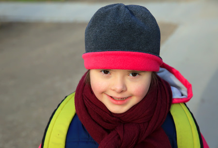 special education: Little girl enjoy outside in the winter