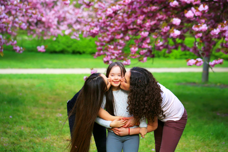 free education: Happy family moments in the park Stock Photo