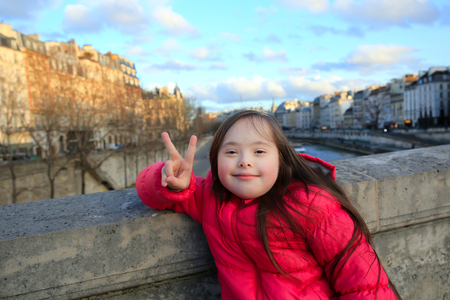 Portrait of little girl smiling in Paris
