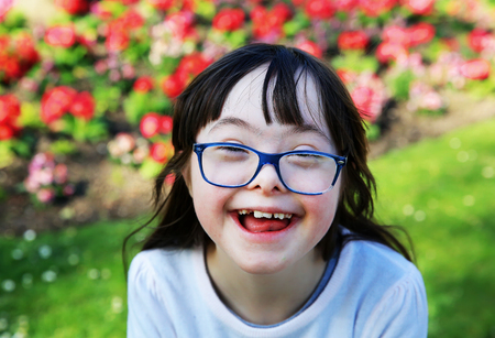 Portrait of little girl smiling outside Stock Photo - 75466325