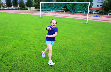 Little girl have fun on the stadium Stock Photo