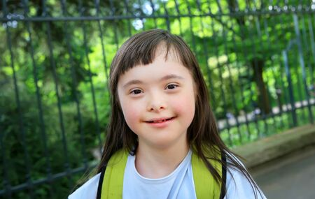 Down syndrome girl in the park