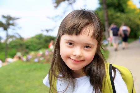 Portrait of little girl smiling outside