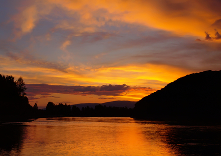 Evening landscape with sunset on the mountain river. Lizenzfreie Bilder