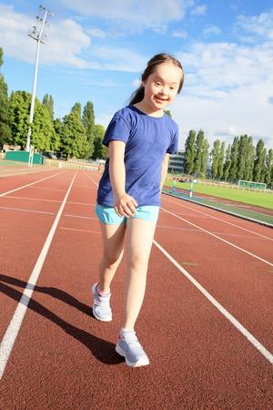 Little girl have fun on the stadium Lizenzfreie Bilder