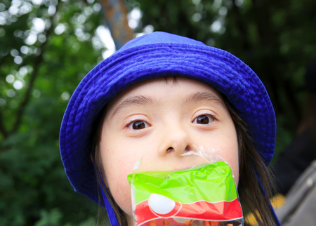Funny little girl with a snack