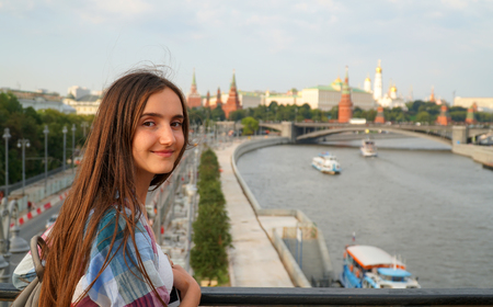 Portrait of beautiful girl on the Moscow city background