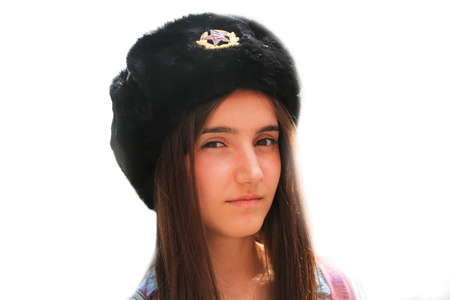 Beautiful girl with a Soviet Union hat isolated on the white Lizenzfreie Bilder