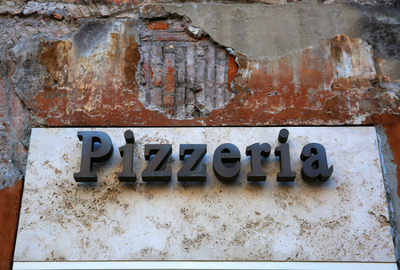 Vintage pizzeria sign in Italy
