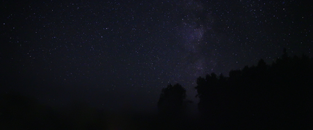 Night sky over rural landscape. Beautiful night starry sky