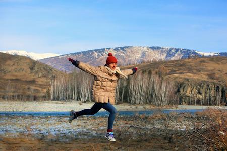 Beautiful teenage girl have fun in the mountains