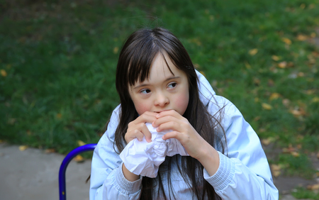Young girl eating in the park Standard-Bild
