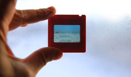 Photo slide in the hand Standard-Bild