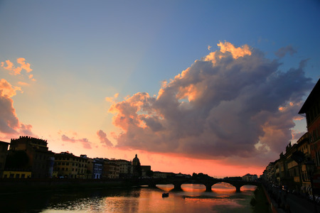 Florence, Ponte alla Carraia medieval Bridge landmark on Arno river, sunset landscape. Tuscany, Italy.