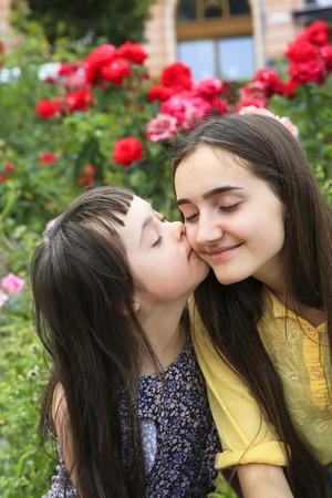 Happy family moments in the park Standard-Bild