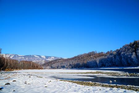 Winter landscape with Katun river at Altai mountains Standard-Bild