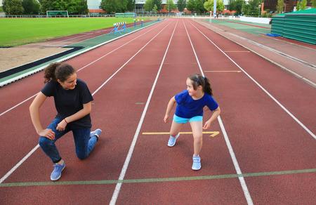 Little girl have fun on the stadium Standard-Bild