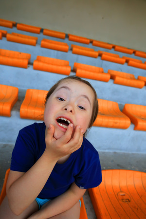 Little girl have fun on the stadium Standard-Bild