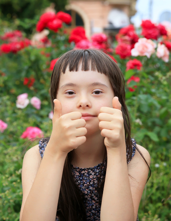 Little girl have fun in the city park Stock Photo