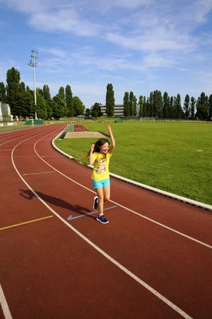 Little girl have fun on the stadium 版權商用圖片