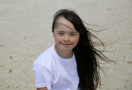 Portrait of down syndrome girl smiling