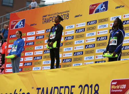 TAMPERE, FINLAND, July 12: HIMA DAS  (India) win gold medal in 400 metrs on the IAAF World U20 Championship in Tampere, Finland 12th July, 2018. 写真素材 - 111543447
