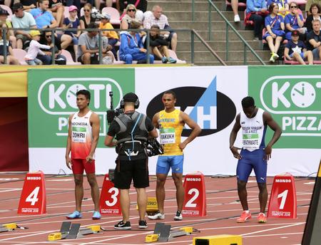 TAMPERE, FINLAND, July 11: LALU MUHAMMAD ZOHRI (Indonesia),VASYL MAKUKH (Ukraine),RIKKOI BRATHWAITE  (IVB) in 100 m. Semi-Final on the IAAF World U20 Championship in Tampere, Finland 11 July, 2018. Editorial