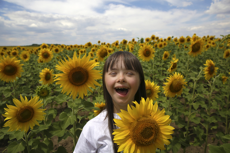 Little girl in sunflowers field