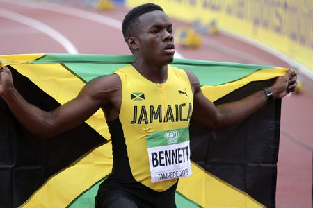 TAMPERE, FINLANDE, le 12 juillet : ORLANDO BENNETT de Jamaïque remporte l'argent sur 110 mètres haies au Championnat du monde IAAF U20 à Tampere, Finlande, le 12 juillet 2018.