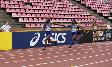 TAMPERE, FINLAND, July 13: TAMARA CLARK and DAIJA LAMPKIN form USA on 4X100 metres relay the IAAF World U20 Championship in Tampere,  Finland 13 July, 2018.