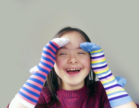 Beautiful girl have fun with socks Stock Photo