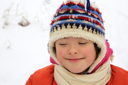 Portrait of beautiful little girl in the winter