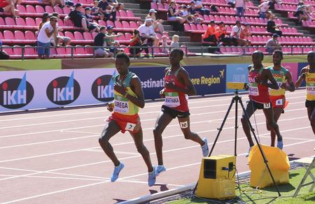 TAMPERE, FINLAND, July 14: SELEMON BAREGA from Ethiopia, STANLEY WAITHAKA MBURU and EDWARD ZAKAYO PINGUA (Kenya) running 5000 meter on the IAAF World U20 Championship in Tampere, Finland 14 July, 2018 Редакционное