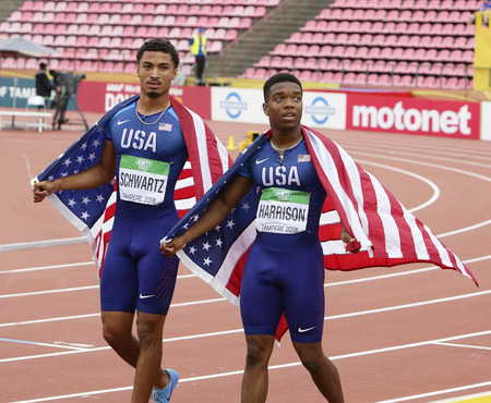 TAMPERE, FINLAND, July 11: ANTHONY SCHWARTZ and ERIC HARRISON (USA) win silver and bronze medals in 100 metrs on the IAAF World U20 Championship in Tampere, Finland 11 July, 2018. Редакционное