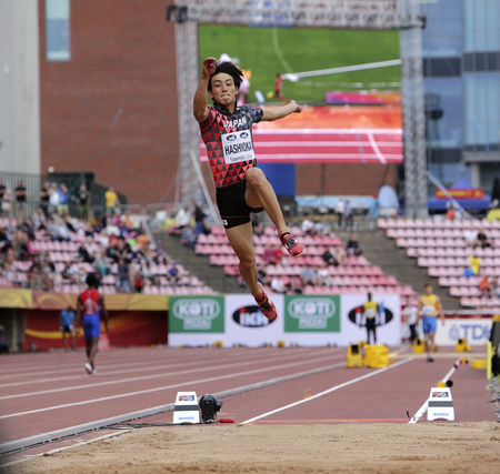 TAMPERE, FINLAND,  July 11: YUKI HASHIOKA from Japan win gold in the long jump final at the IAAF World U20 Championships in Tampere, Finland on July 11, 2018. Редакционное