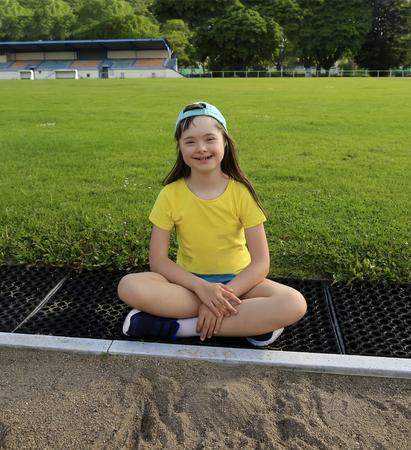 Little girl have fun on the stadium Foto de archivo