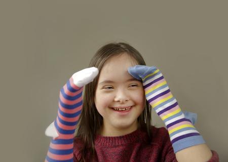 Beautiful girl smiling with socks