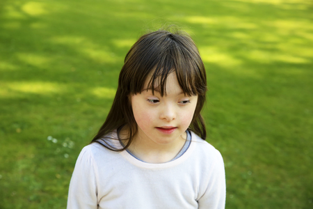Portrait of the little girl in the park