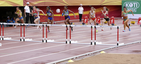 TAMPERE, FINLAND, July 12: Athletes running 100 meters hurdles on IAAF World U20 Championships in Tampere, Finland 12 July, 2018 Editorial