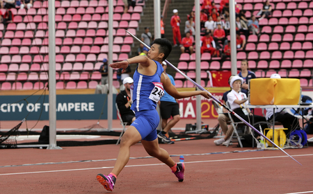TAMPERE, FINLAND, July 11: HUIJUN LI from CHINESE TAIPEI on the javelin throw event in the IAAF World U20 Championship in Tampere, Finland 11 July, 2018. Foto de archivo - 126230071