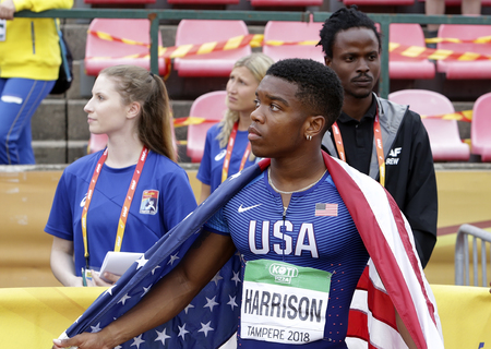 TAMPERE, FINLAND, July 11:  ERIC HARRISON (USA) win bronze medal in 100 metrs on the IAAF World U20 Championship in Tampere, Finland 11 July, 2018. Foto de archivo - 126230092