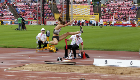 TAMPERE, FINLAND,  July 12: LEA-JASMIN RIECKE from Germany win gold medal in the long jump on the IAAF World U20 Championships on July 13, 2018. Foto de archivo - 126230099